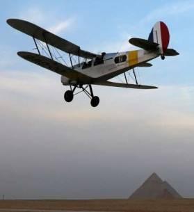 Vintage biplane lands at Giza Pyramids