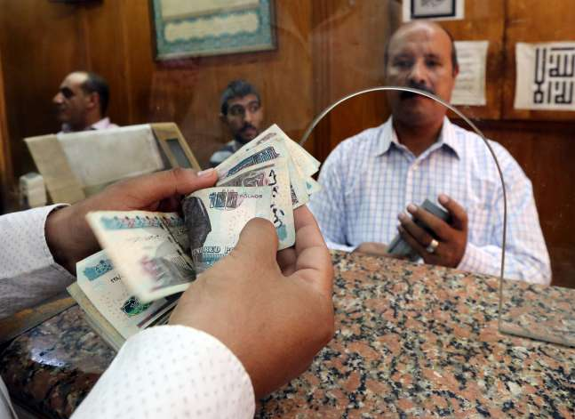 Egypt's pound weakens as dollar demand surges, interest rates steady