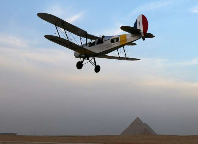 Vintage biplane lands at Giza Pyramids