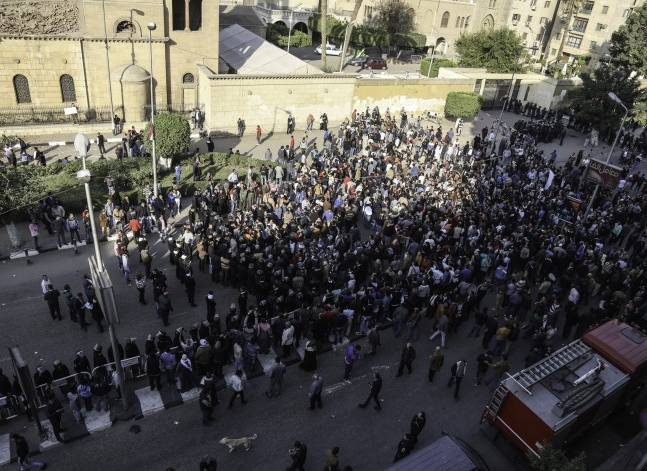 Hundreds gather outside Coptic Orthodox cathedral after explosion