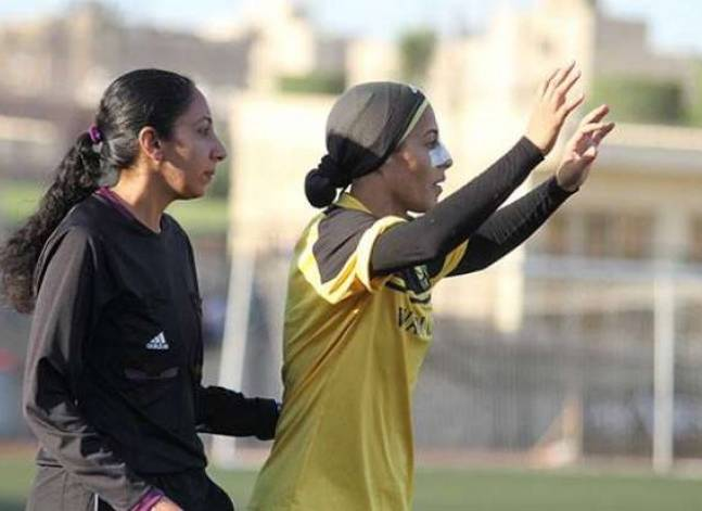 Woman, Egyptian, veiled and football midfielder