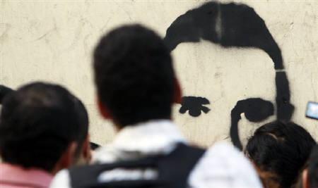 UPDATE   Egypt jails policemen for activist's death that triggered Mubarak uprising