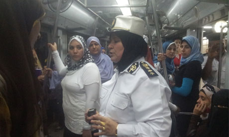 Policewomen patrol women's carriages on Cairo's packed metro