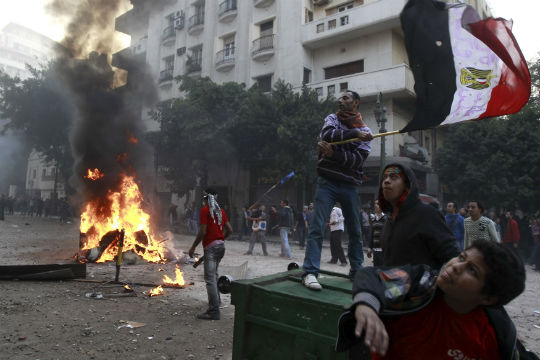 Egypt arrests 18 in scuffles near Tahrir