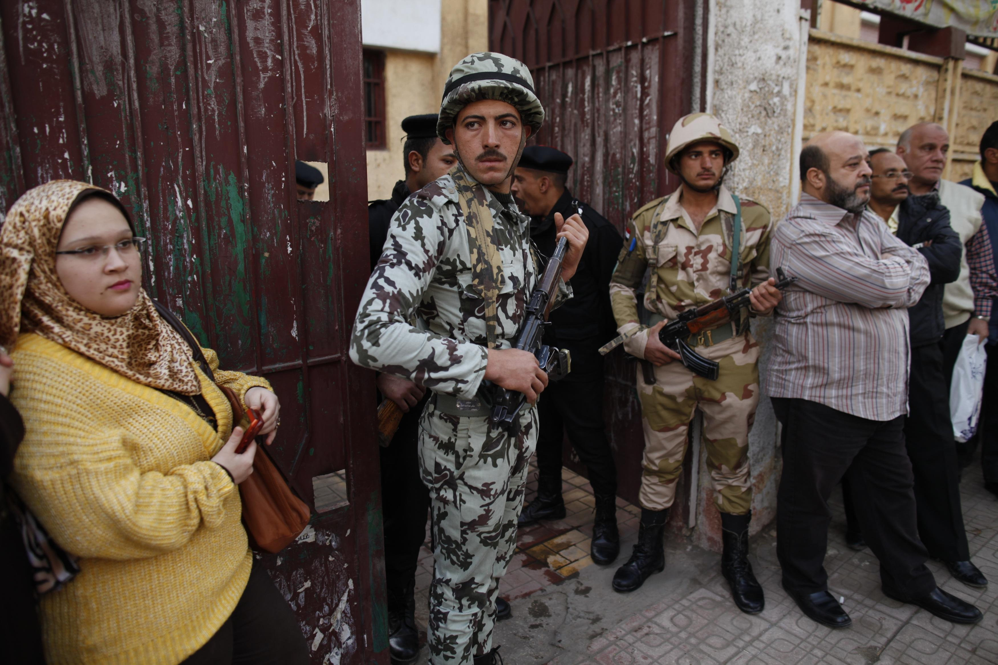 Egyptians vote on divisive constitution