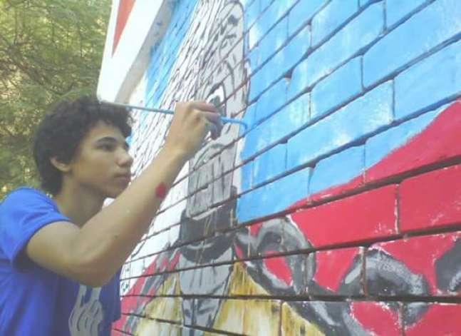 """""""تاجر البساطة"""".. معرض لتخليد ذكرى رسام الجرافيتي """"هشام رزق"""""""