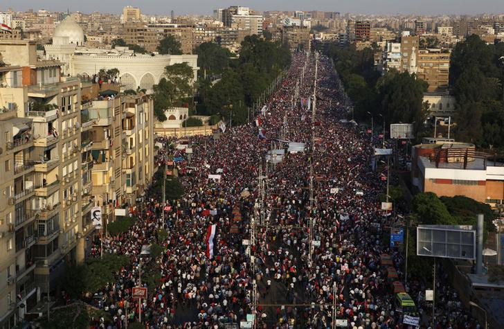 بنك أوف أمريكا يتوقع أن تبلغ التزامات الديون الخارجية لمصر ذروتها مع نهاية فترة السيسي